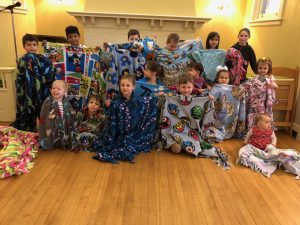 The Saturday Club Kids Create Cozy Blankets for Project Linus